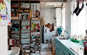 Part kitchen divided by open shelving part laundry room with everything every where....can't even put that bag away for a photo shoot.  I have a headache!