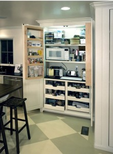 Built-in cabinet pantry with french door style opening and full extension pullout drawers